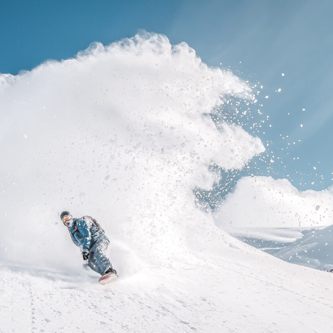 Big spray while snowboarding with First Tours