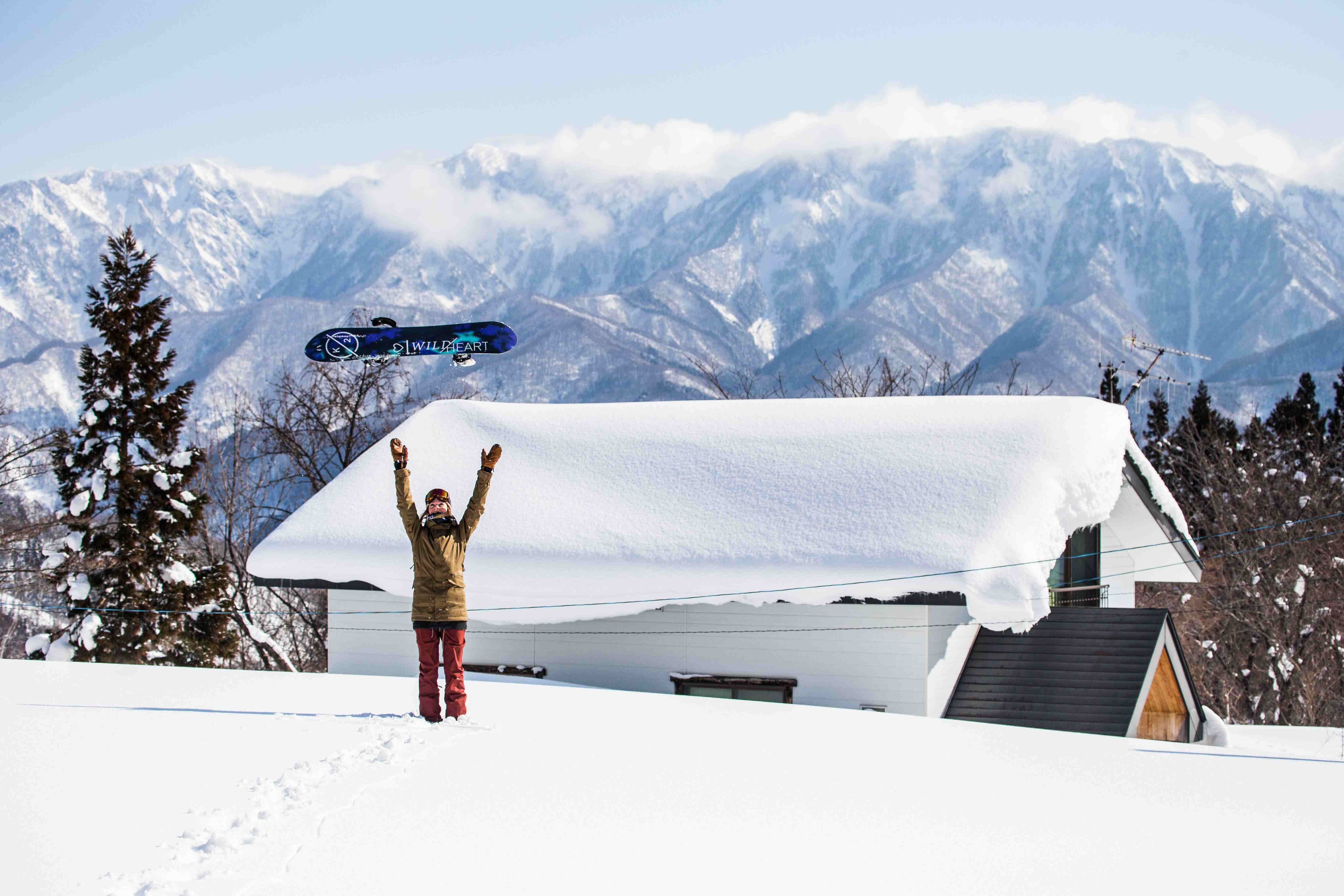 Girls throwing board in the air with Hakuba backdrop