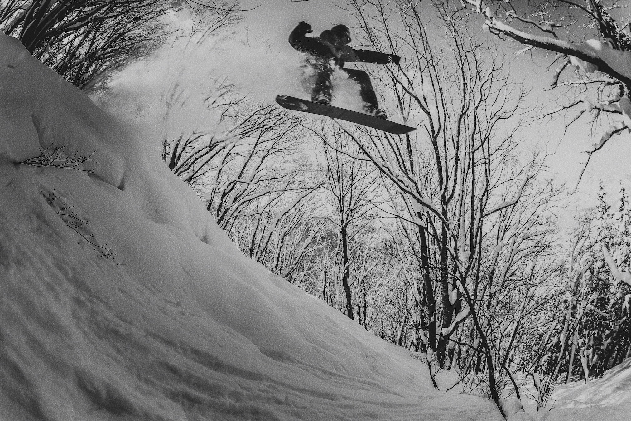 Snowboard jump in Nozawa Onsen during Powder Culture Tour with First Tours