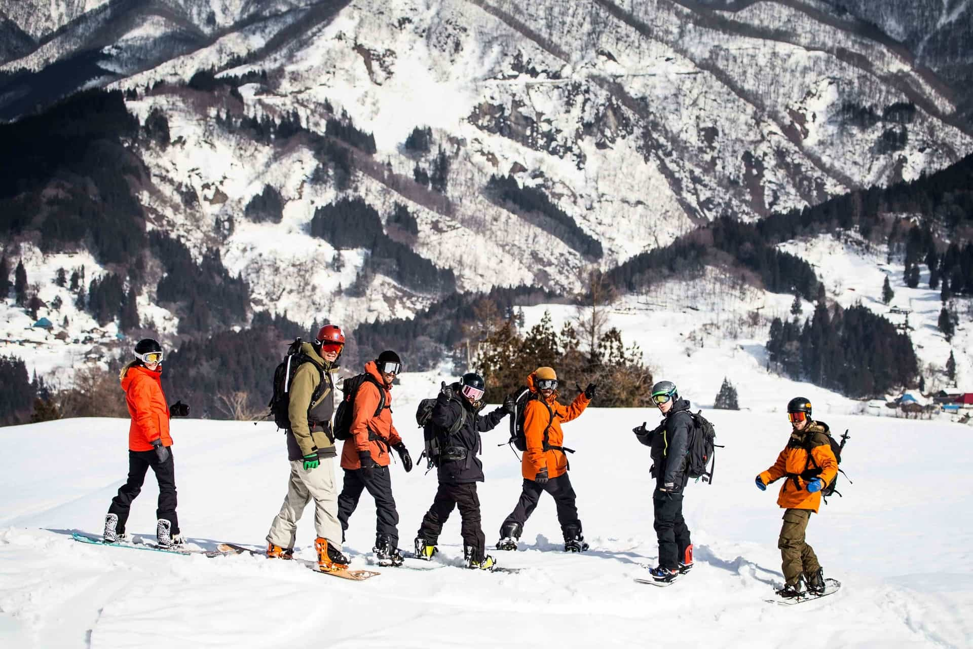 Group is stoked during a fun spring time snowboard run in Japan