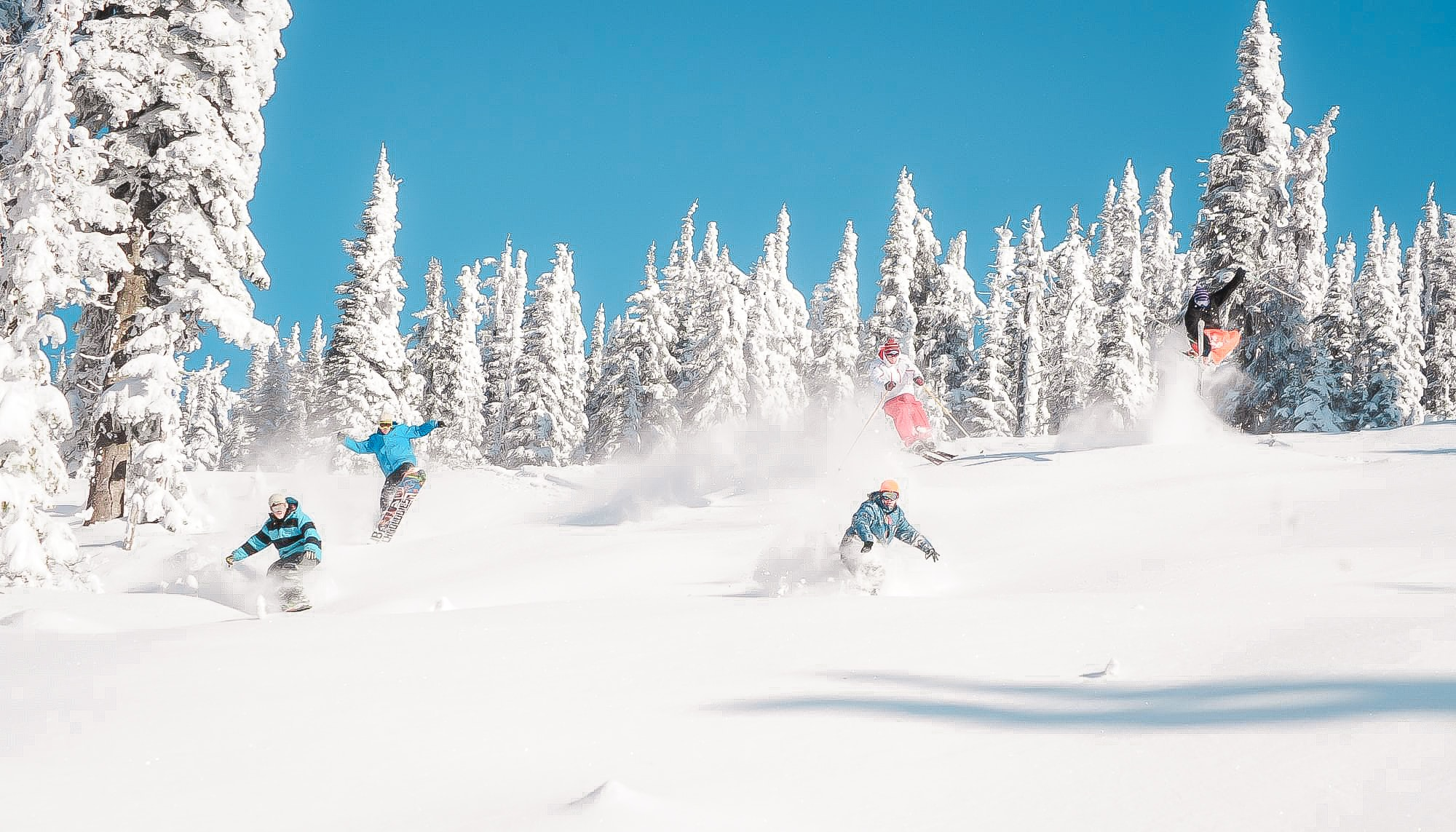 group skiing and snowboarding powder First Tours