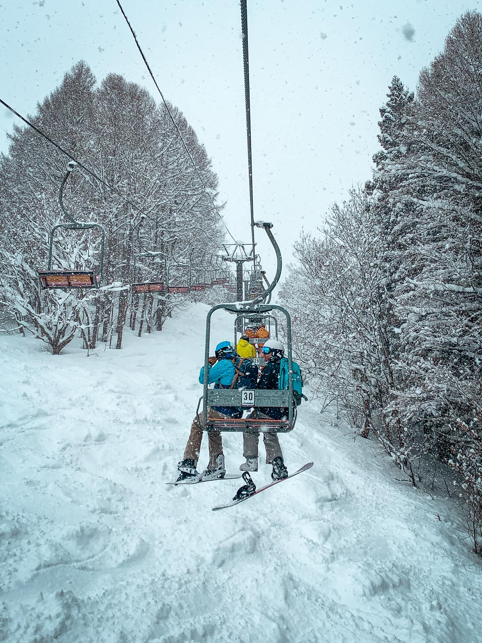 Chairlift while snowing hard during powder culture tour with First Tours