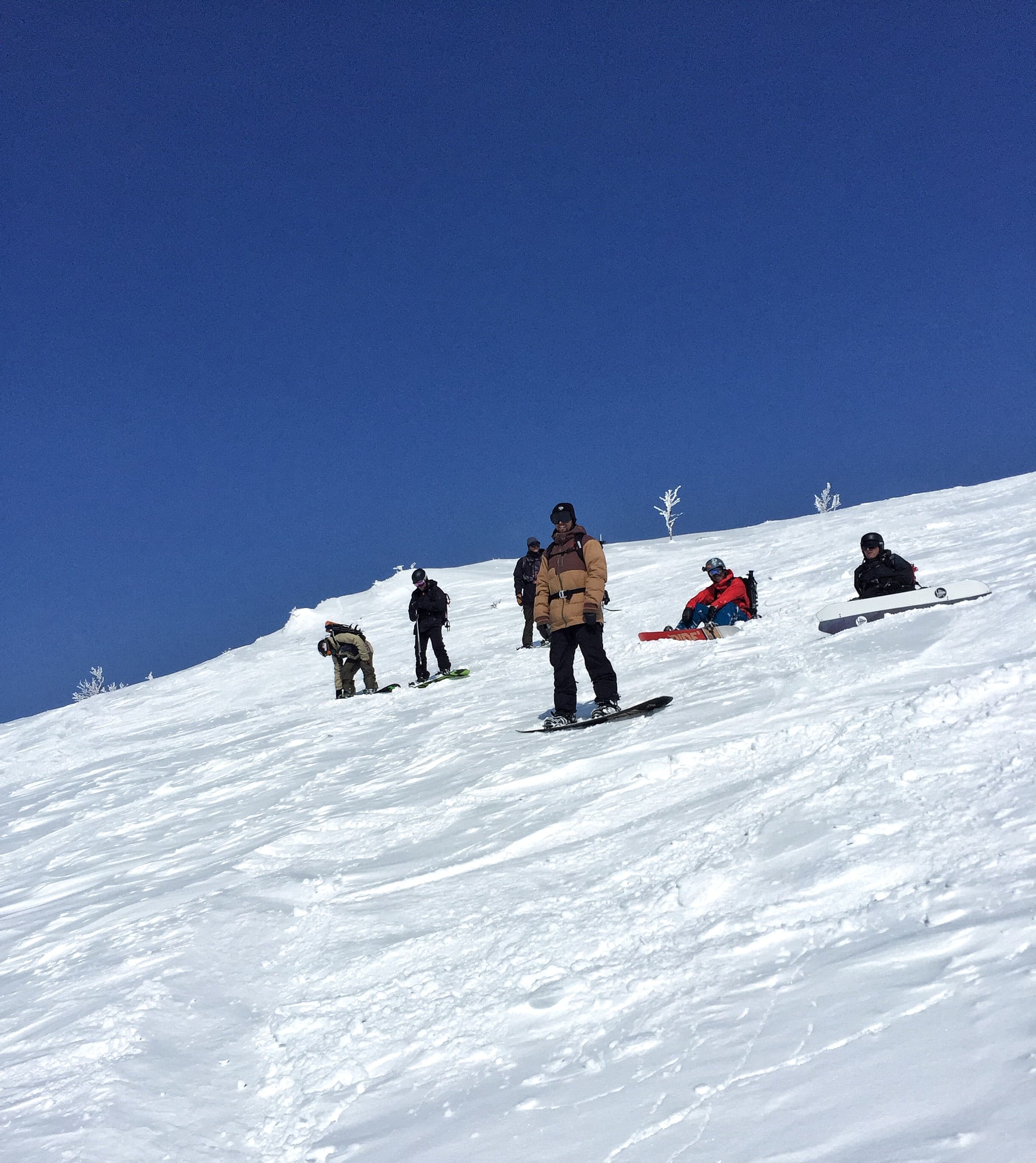Snowboarders waiting to drop Asahidake